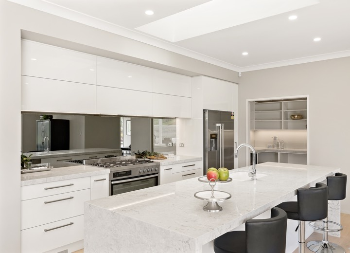 Modern white kitchen with mirror splashback