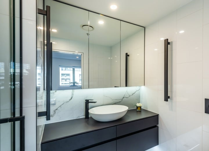 White and dark bathroom cabinetry