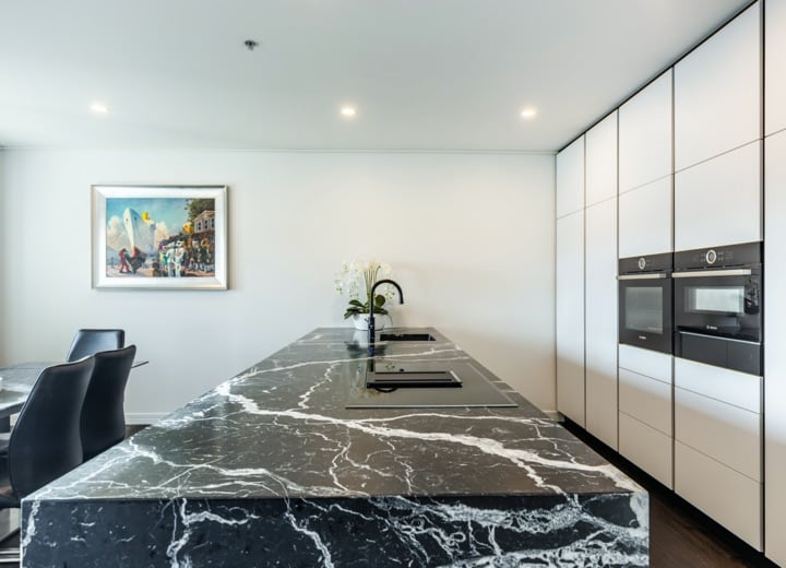 Black granite benchtop kitchen