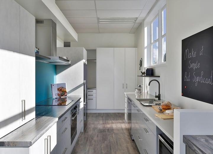 Galley kitchen with blue splashback
