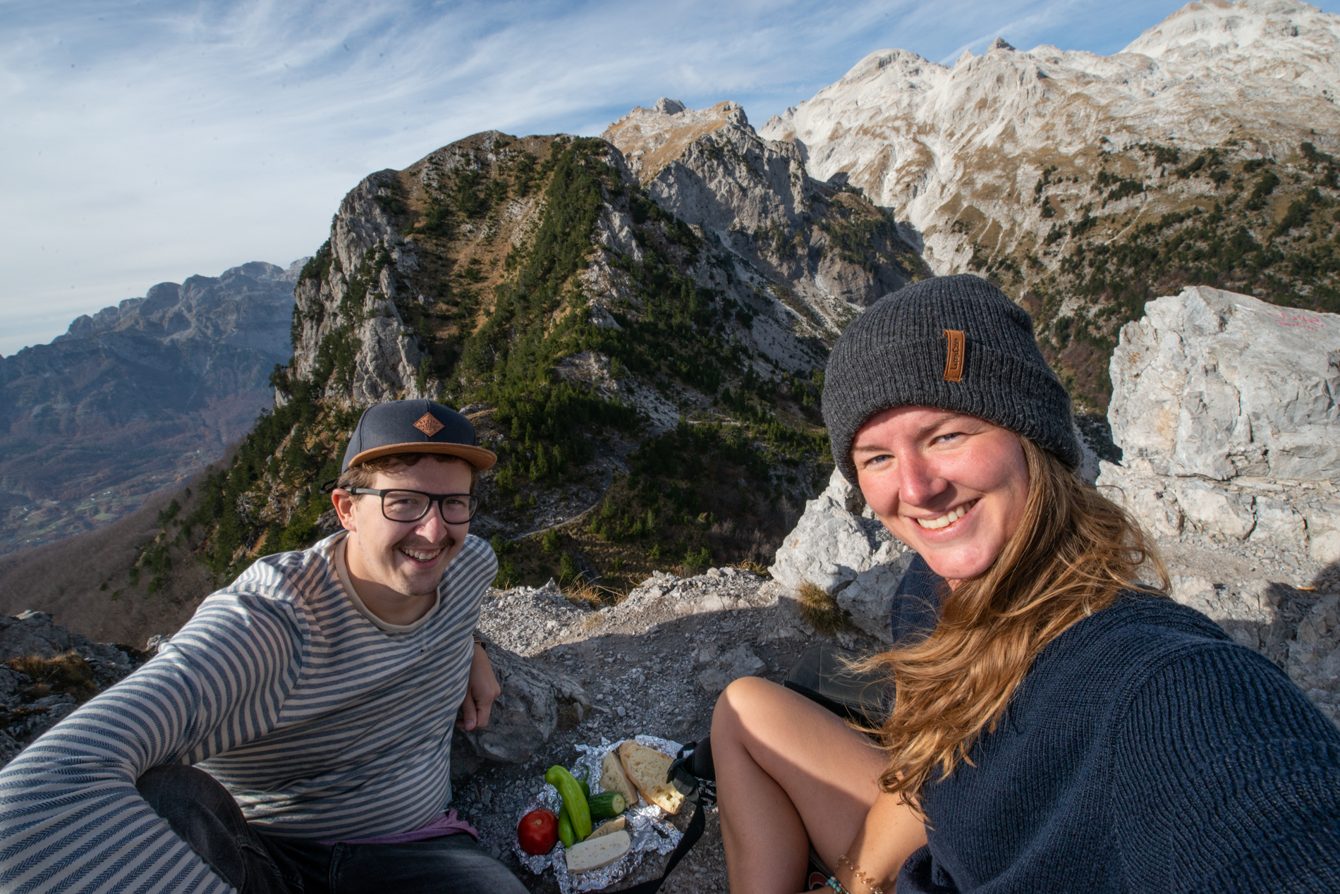 On the top of the Valbona peak, Ellisandme having their lunch. Great mountains on the background.