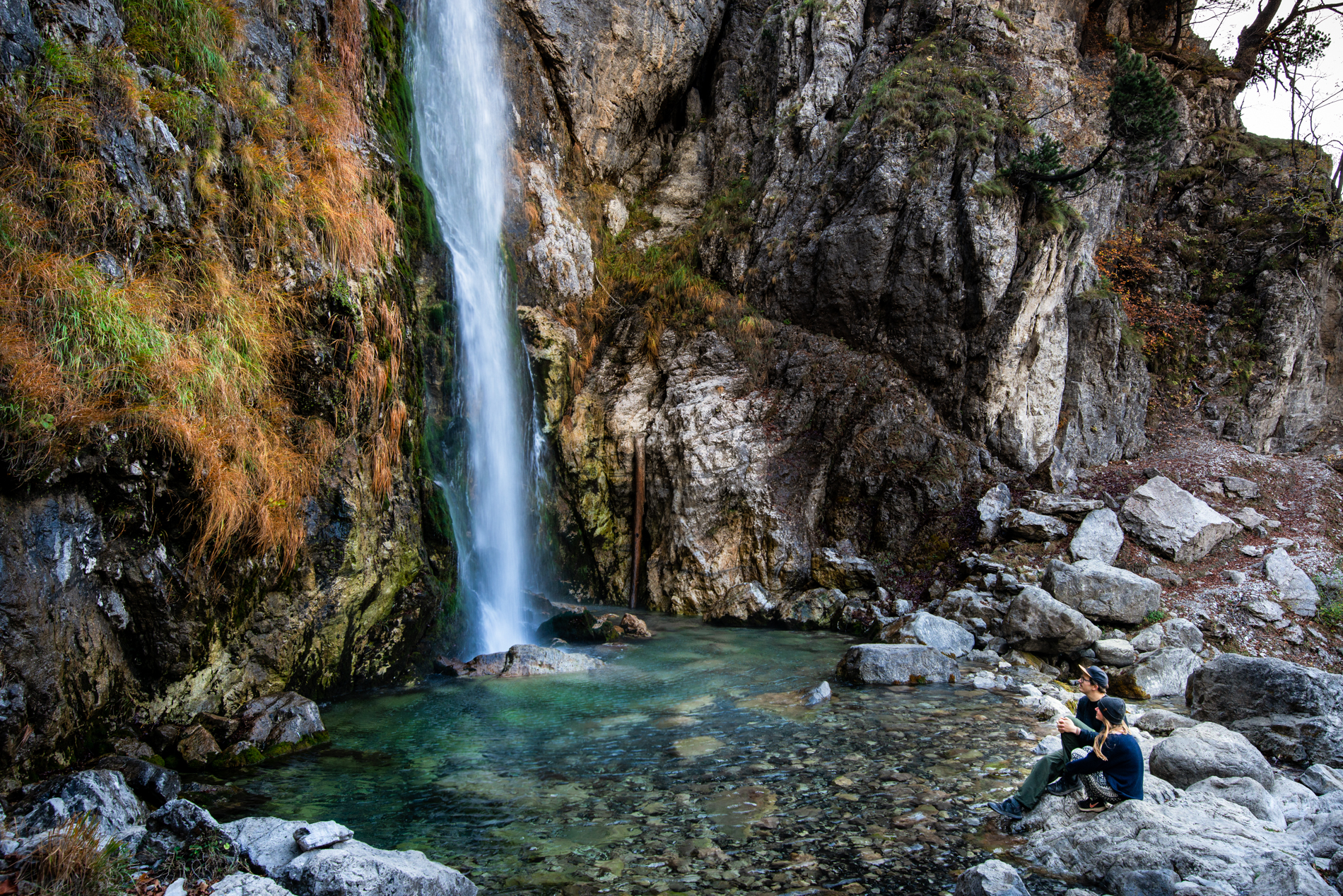 Ellisandme in front of a waterfall in Theth, Albania.