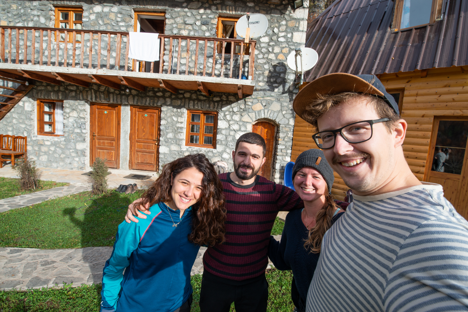 Ellis and me with Albanian tourguides in front of their guesthouse in Theth, ALbania.