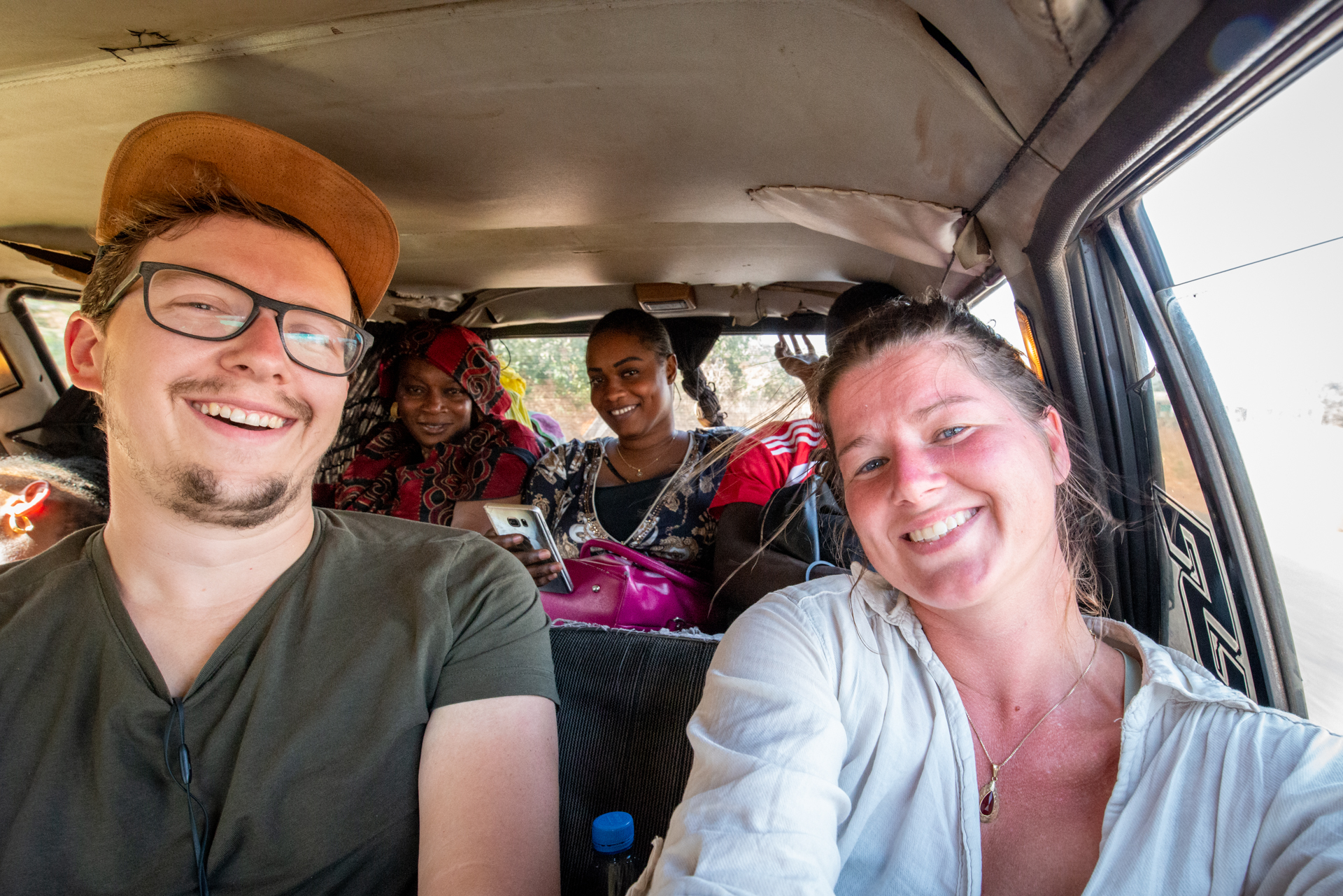 Ellis & me in a 7 seater taxi in Senegal, with 6 other people.