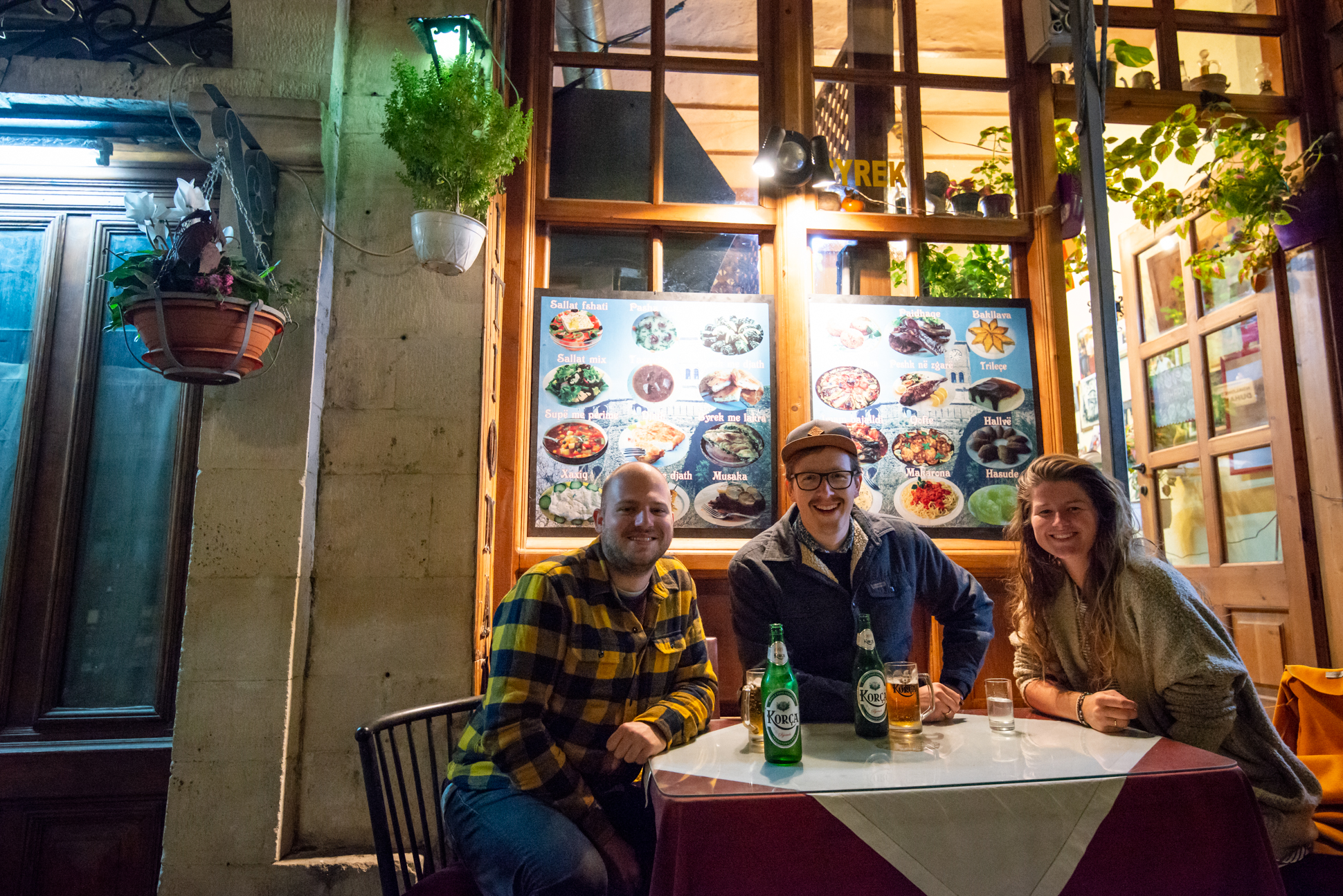 Ellis and me with their friend having diner in front of a very cute restaurant in Gjirokäster, Albania.