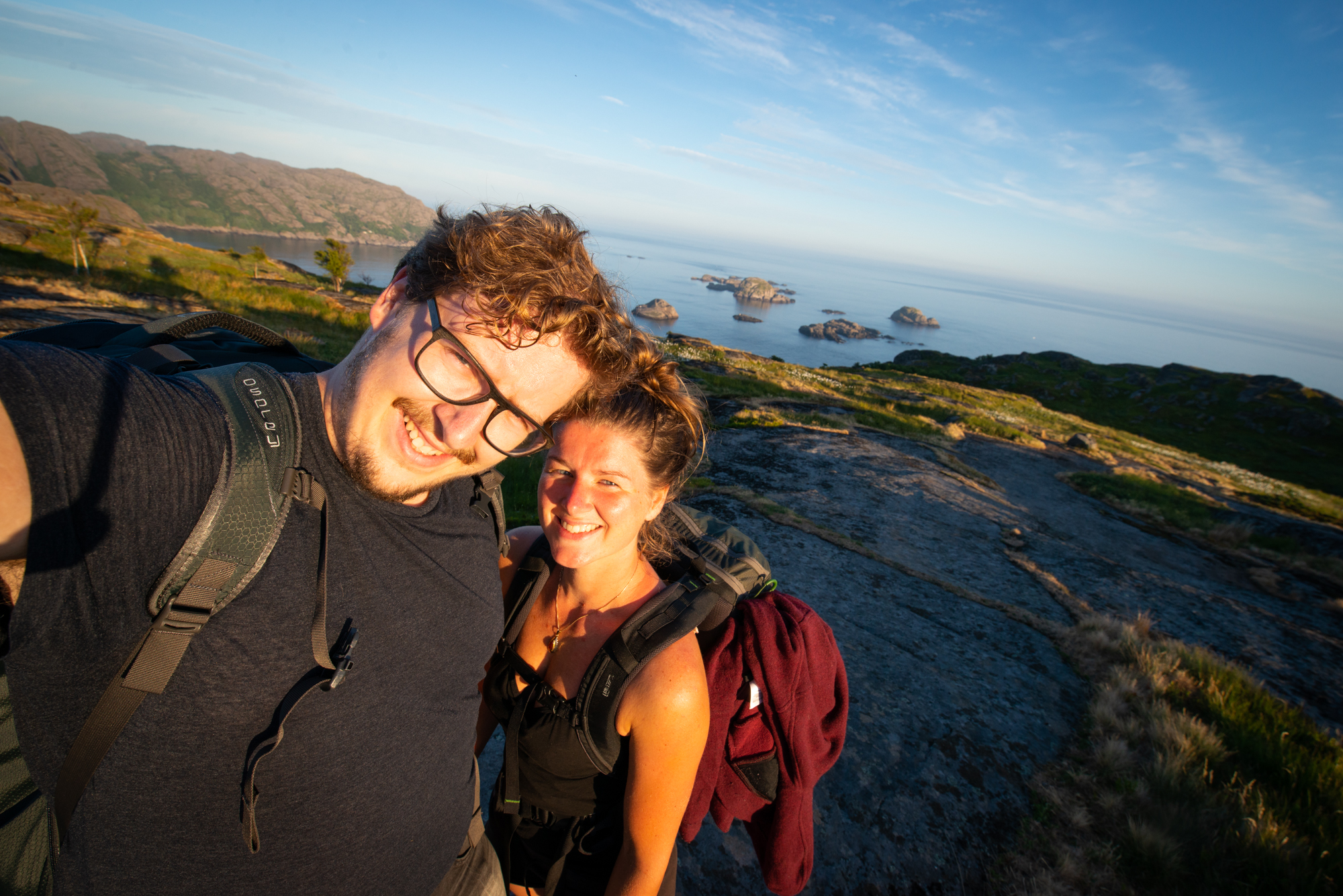 Ellis&me hiking with a sunset and the ocean on the background. Sokndal Norway.