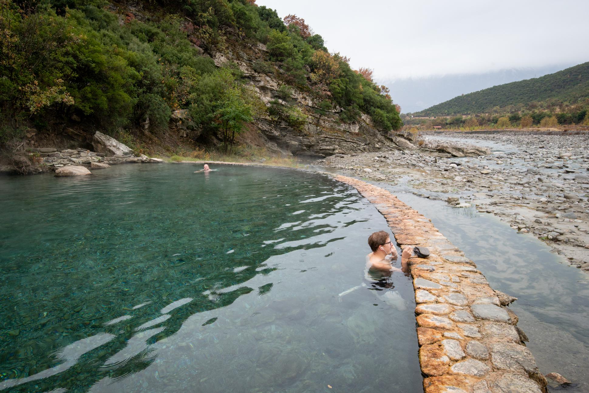 Skype meeting for digital nomad Ellis&me in Benja thermal baths, hotsprings Permet Albania. Ellis Photography.