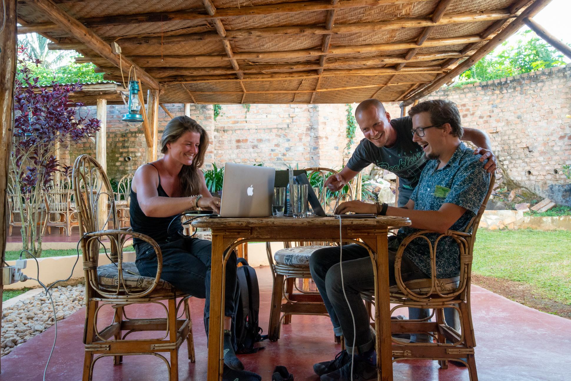 Digital nomad in Uganda in a nice cafe on a sunny day. Ellis & Me.