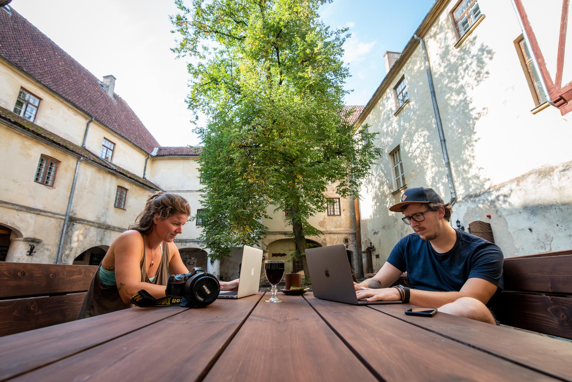 Ellis and me working in the castle of Jaunpils, Latvia. Ellis photography - digital nomads.