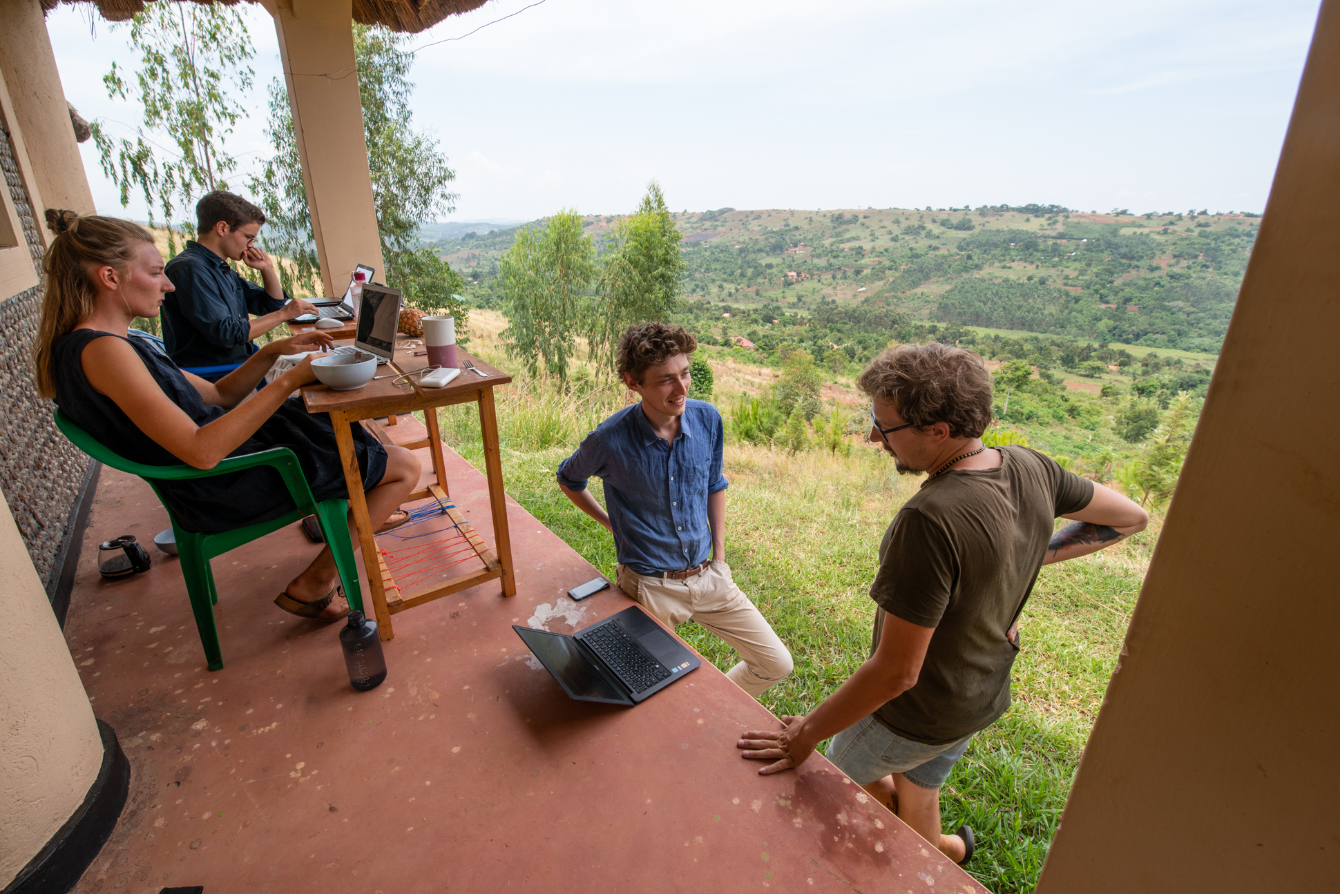 Working in Uganda, SINA as a digital nomad with a great view of green hills.