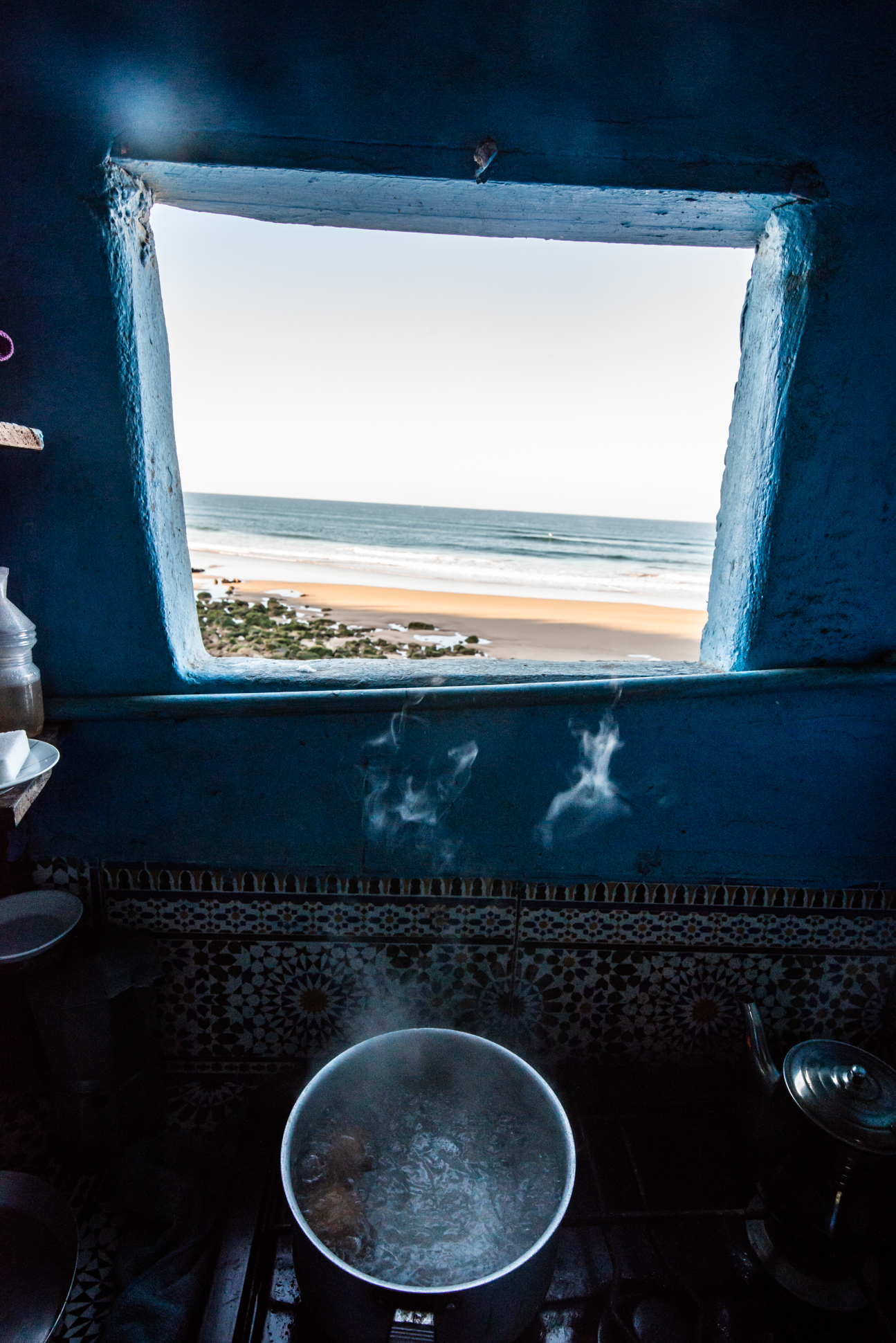 Kitchen with a view on the ocean. Beach life. Boiling eggs