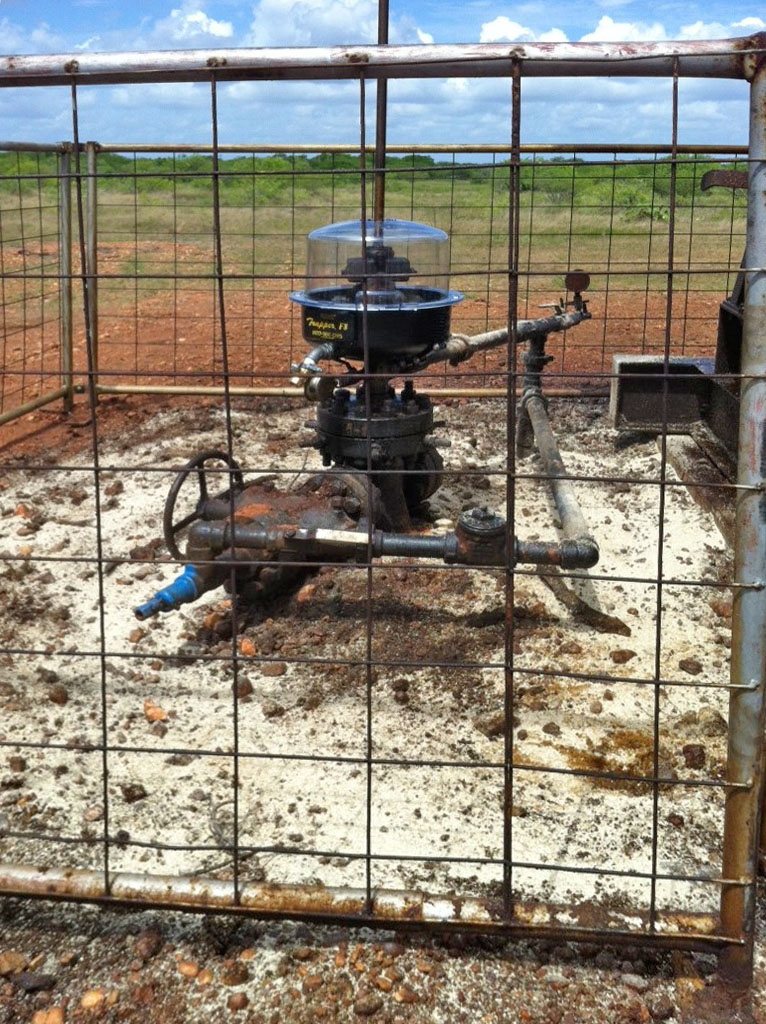 Biosorb oil absorbent cleaning up an oil spill around a Pump jack