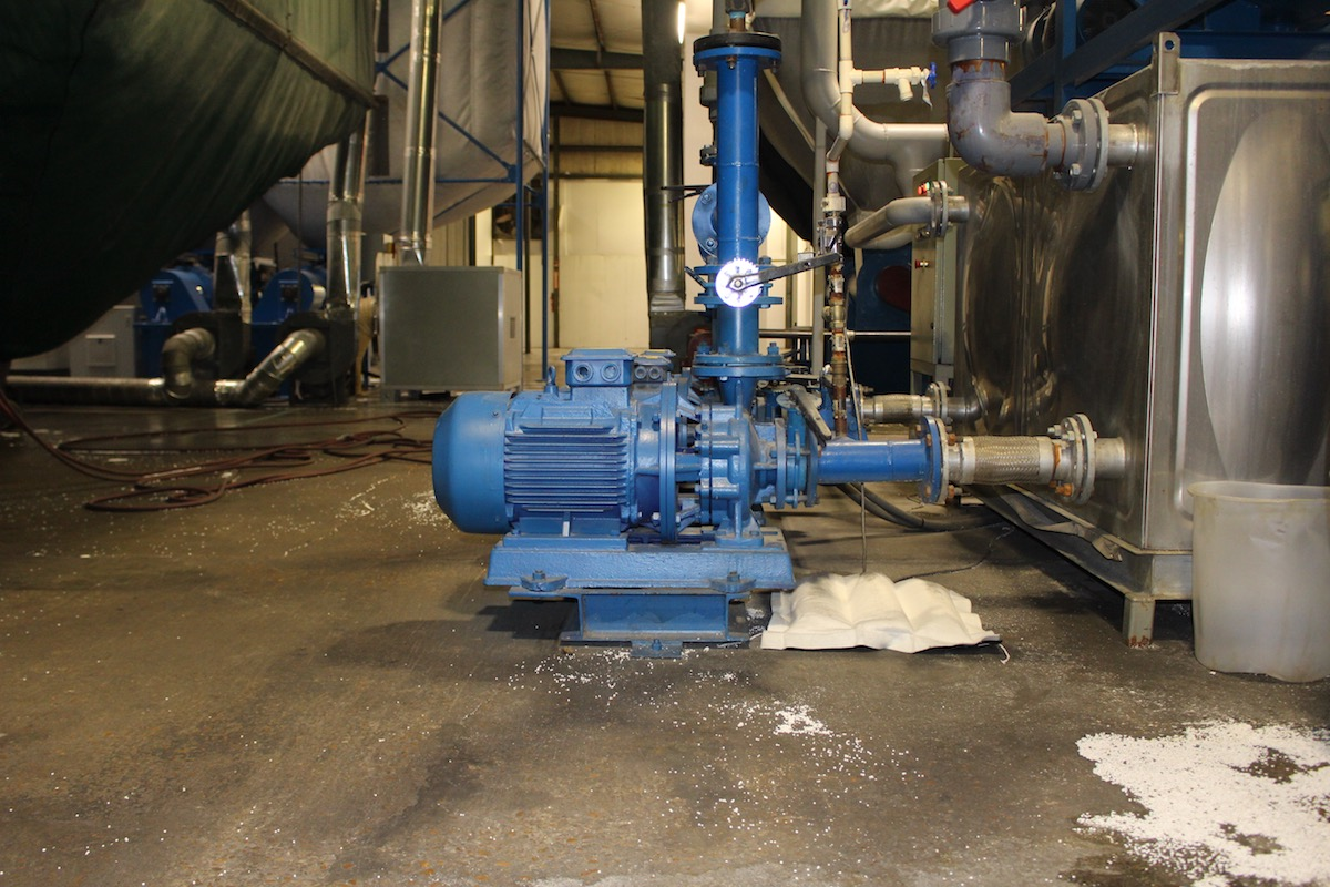Kengro Biosorb Pillow being used for industrial oil spill management on a concrete floor