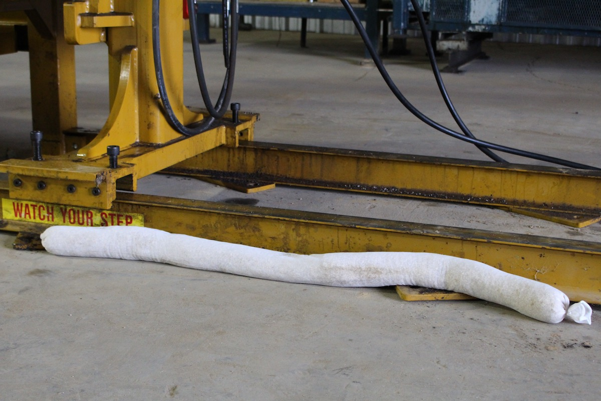 Biosorb absorbent sock being used to clean a spill