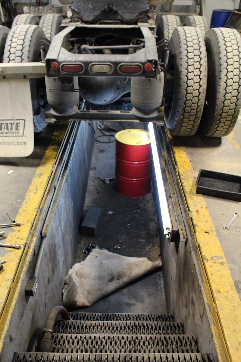 Kengro Biopad being used to absorb falling oil in diesel shop pit