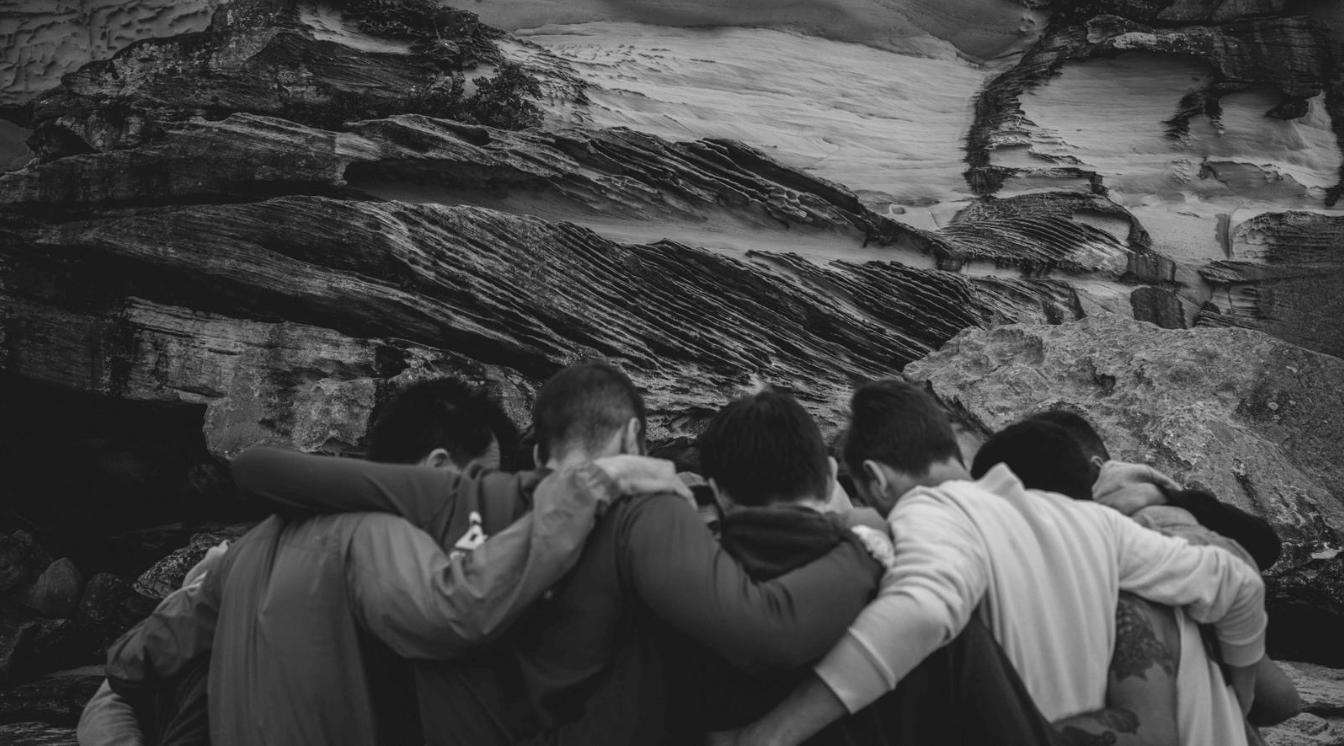 Circle of men hugging