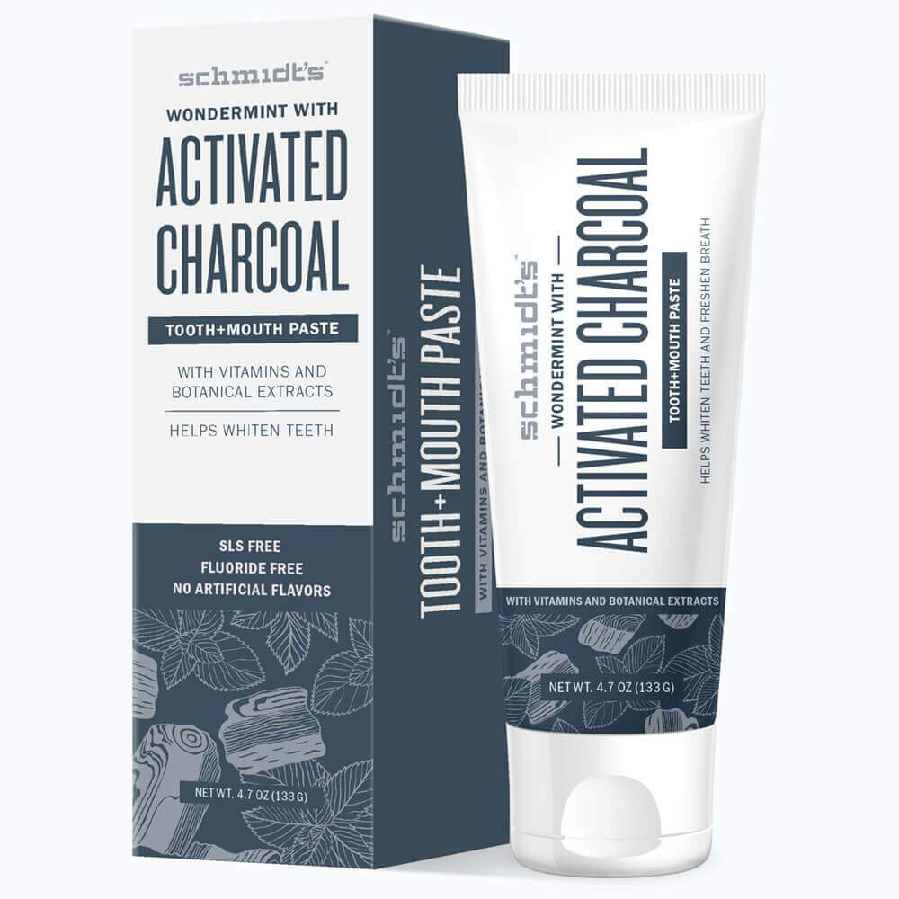 A blue and white box and a tube of Schmidt's Wondermint Activated Charcoal toothpaste are pictured here.