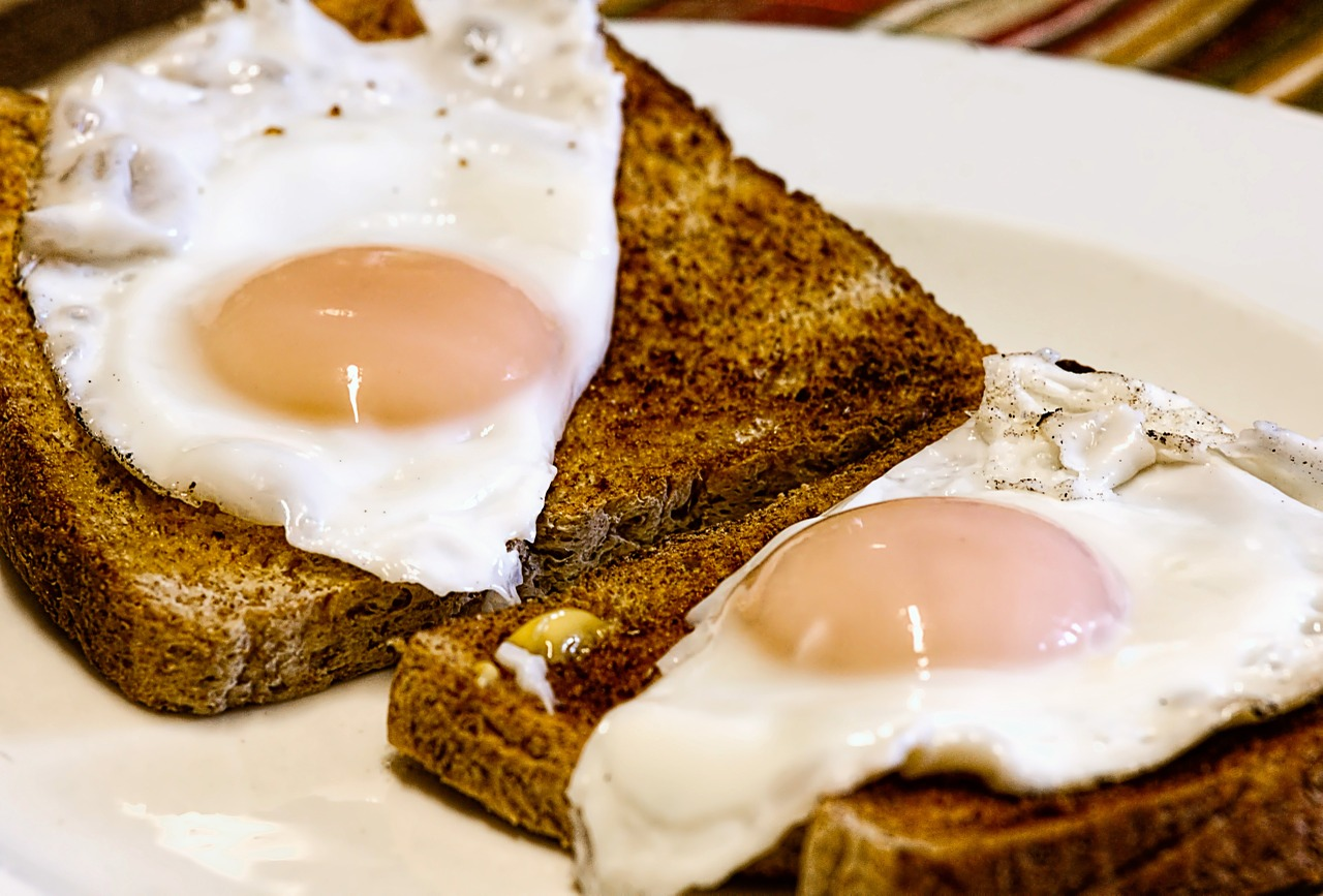 Sunny side up eggs on two pieces of toast