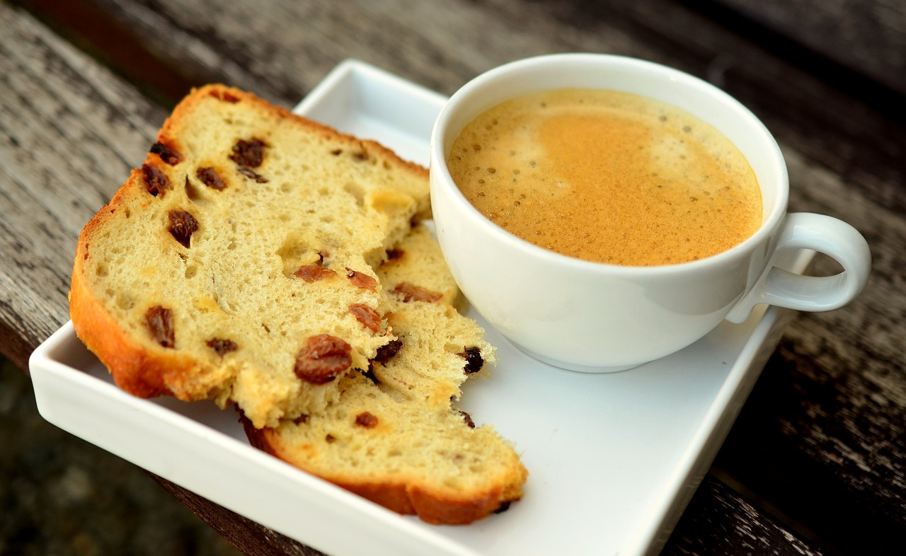 Coffee and bread on a ceramic plate