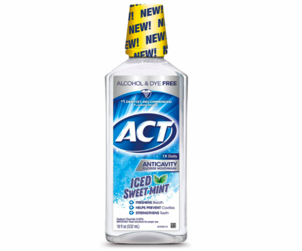 A bottle of ACT mouthwash which is alcohol and dye free.