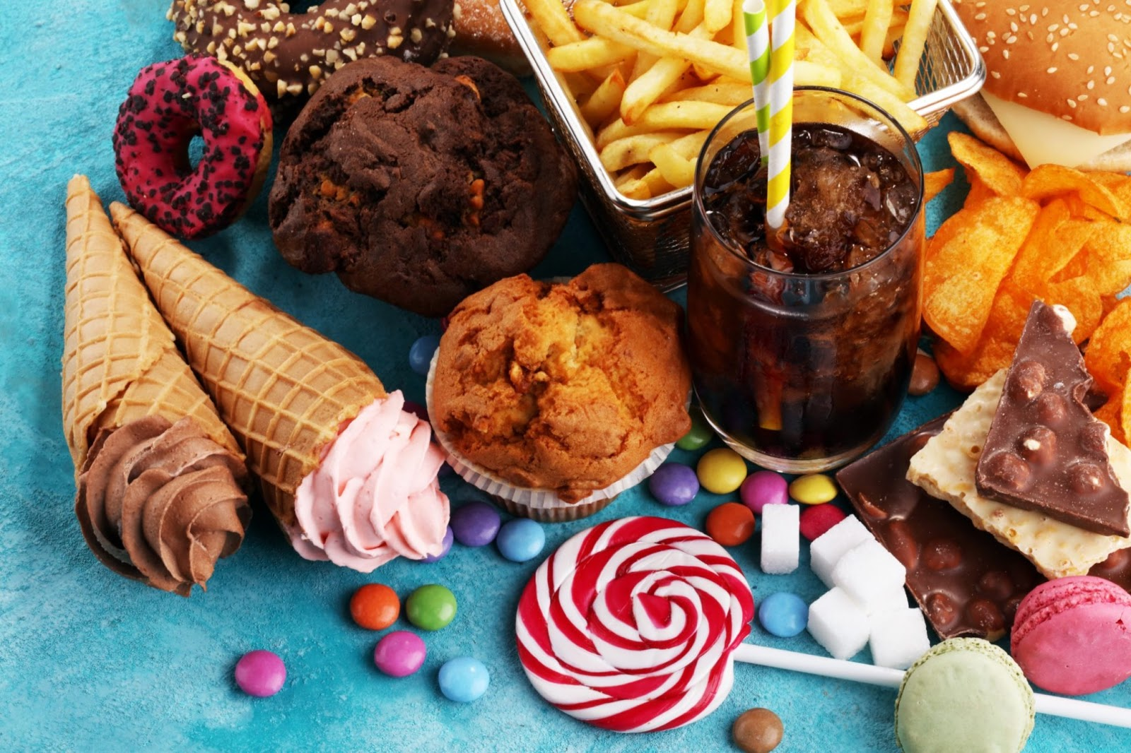 Unhealthy foods like muffins, hard candy, fries, and carbonated drinks.