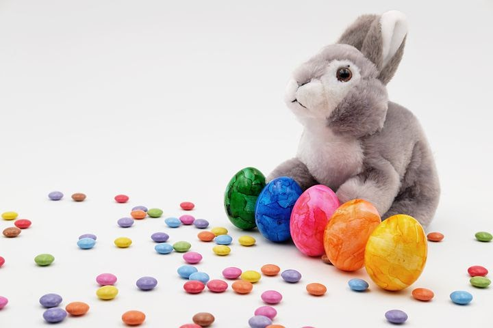 a cute stuffed animal Easter bunny surrounded by candy