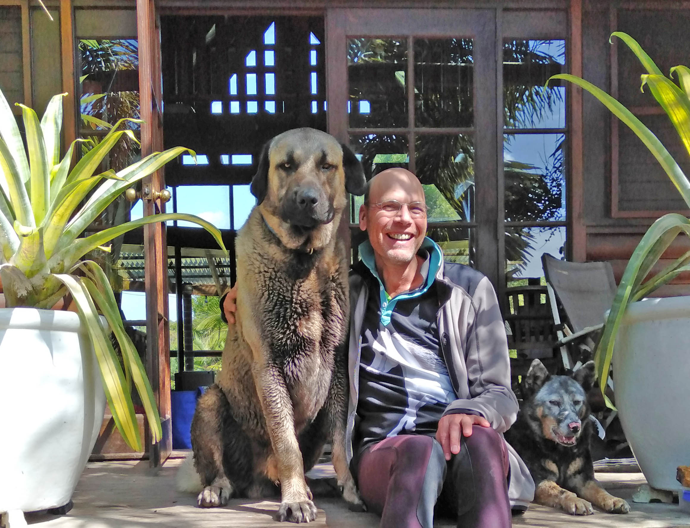 Photo of Matthias and his dog Simba at their home in Mary Valley