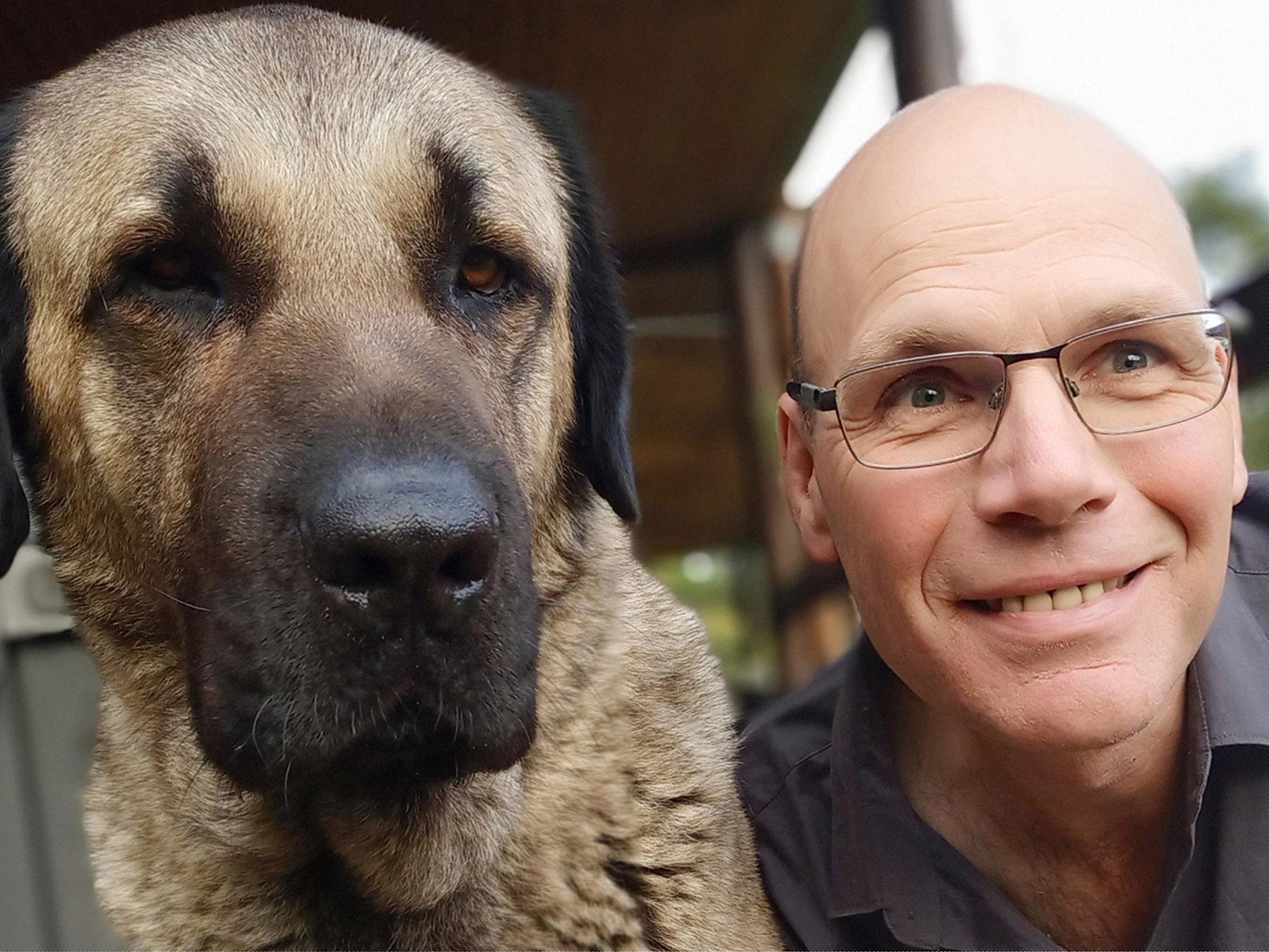 Matt and his dog, Simba.