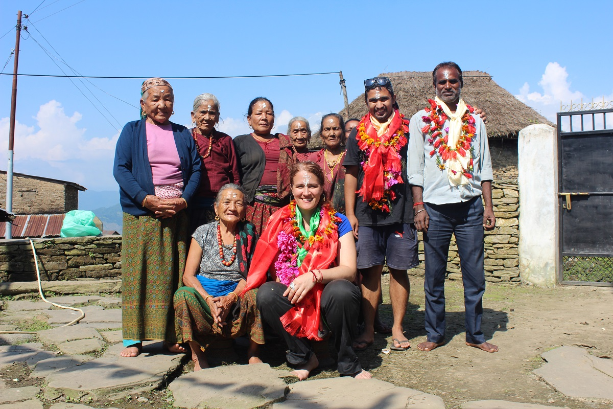 Matriarchs of the Rainaskot village in Nepal with Natasha Wozniak co-founder Bibek K. Pandit, and their contractor Ragu Patel.