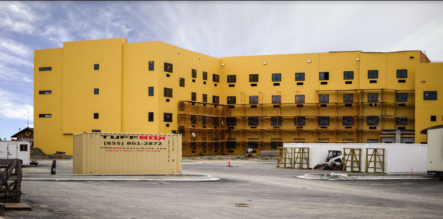 onsite storage containers in front of a hospital under construction