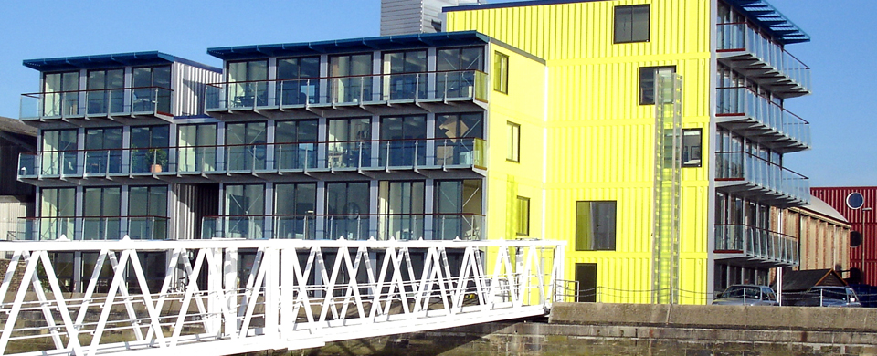 Yellow apartment building made from shipping containers