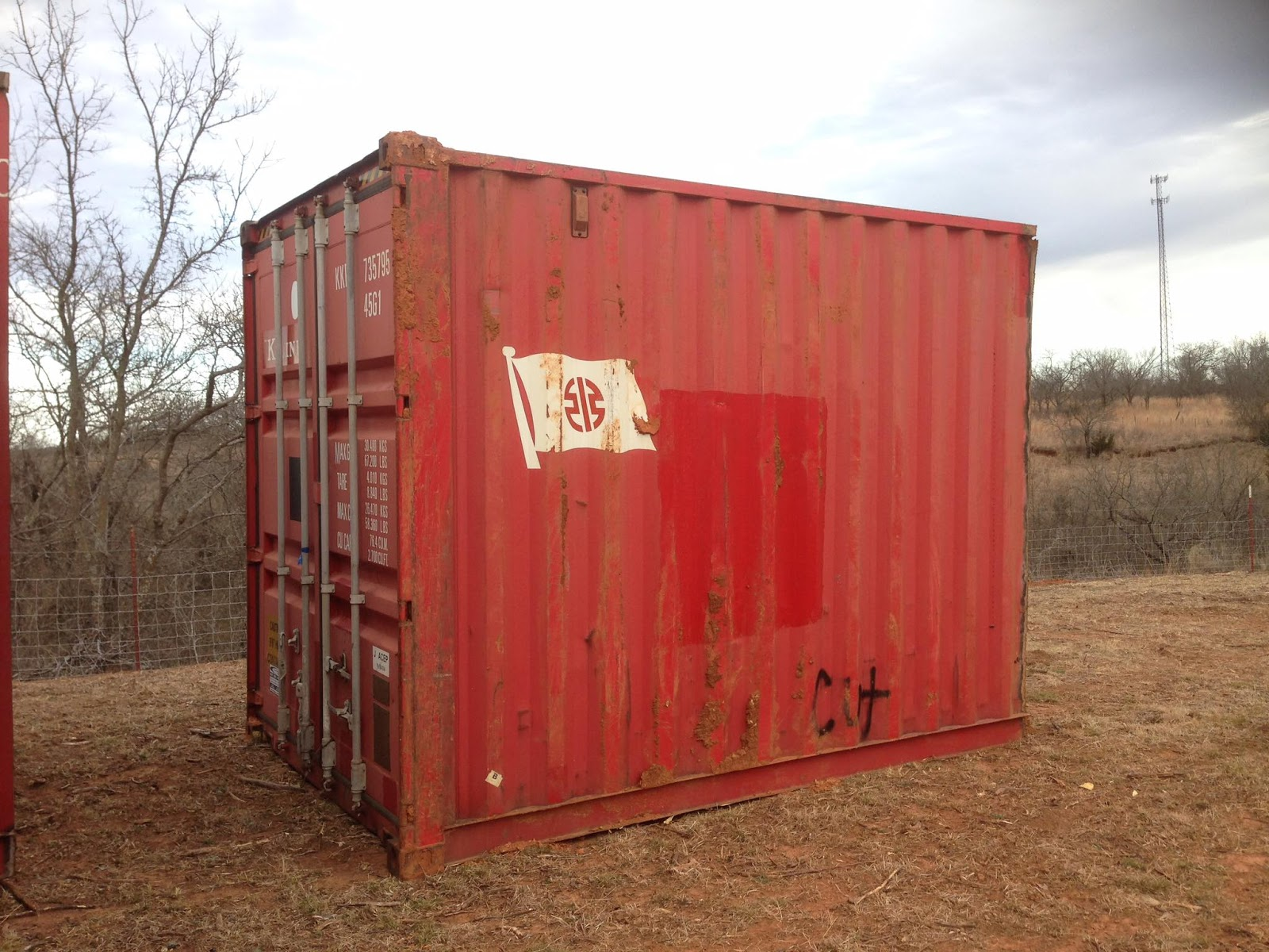 Red 20-foot shipping container cut in half