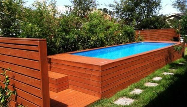 wood siding wrapped shipping container pool