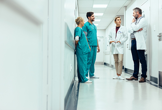 Doctors standing in hospital hallway