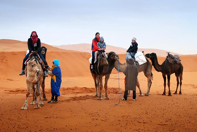 camel ride in the moroccan desert, Morocco