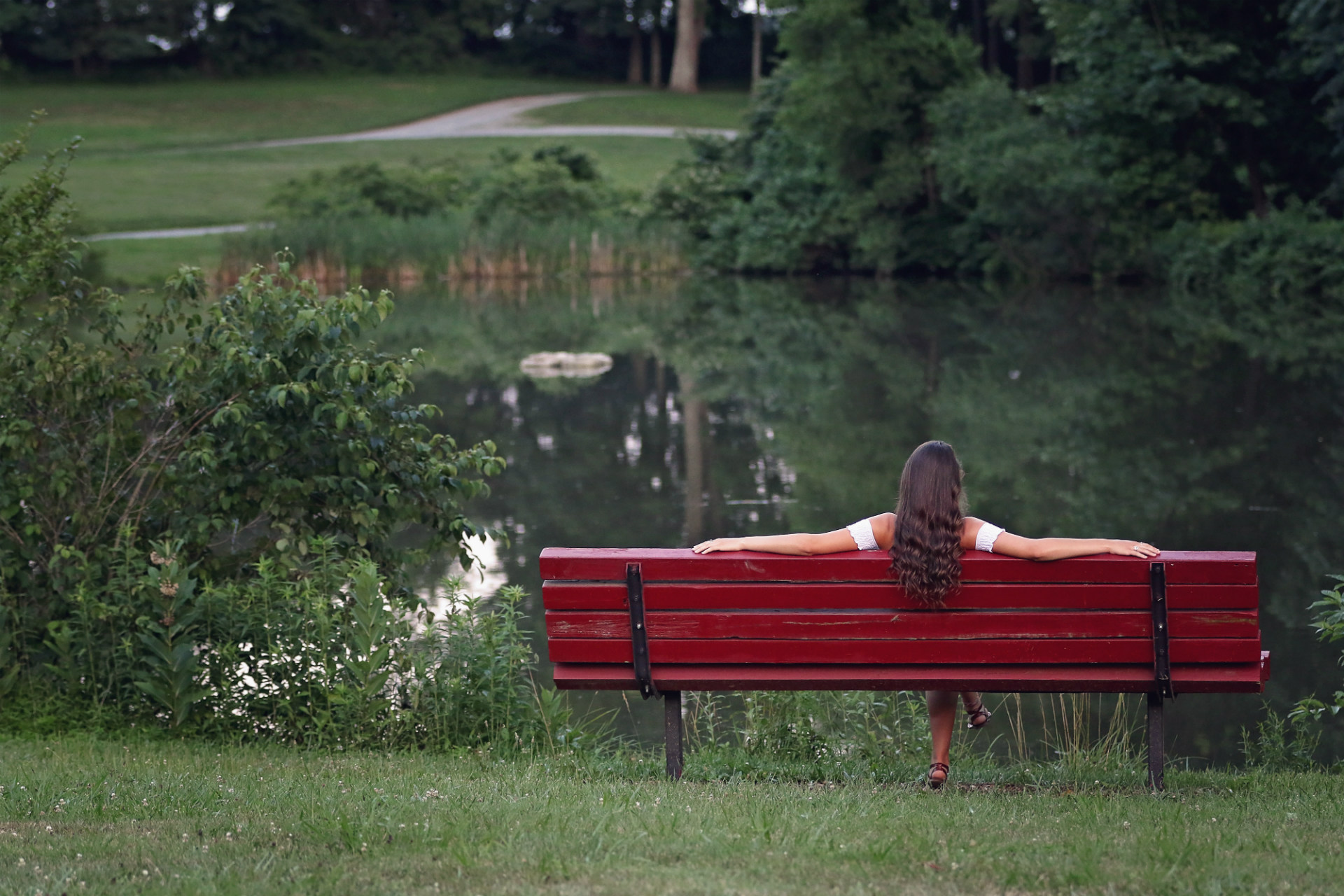 woman on bench in nature
