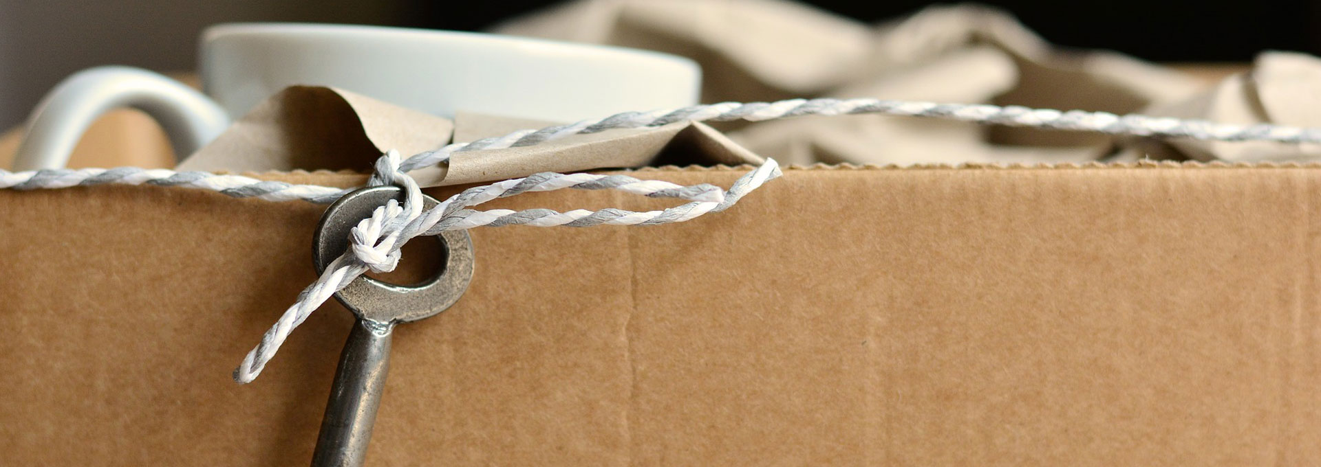 moving box with skeleton key tied with string