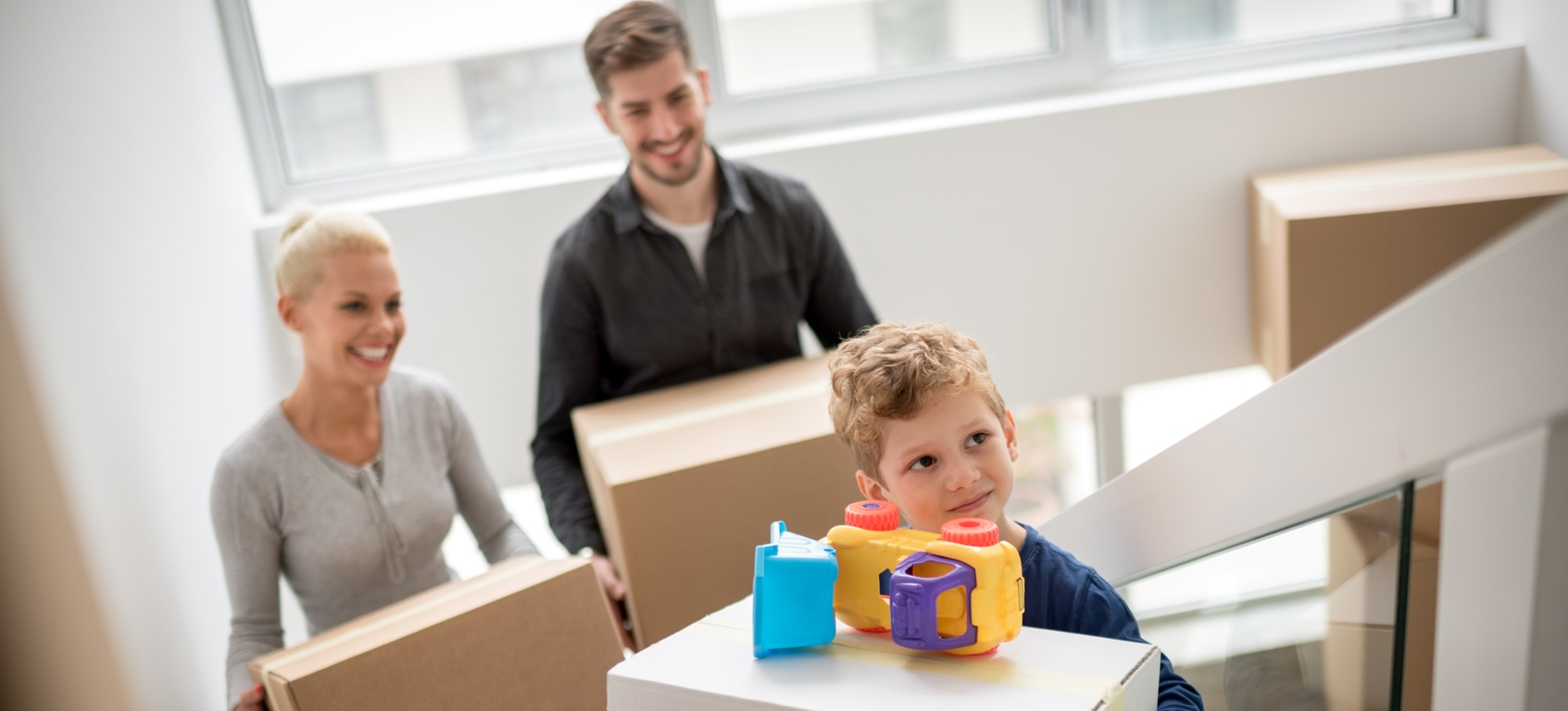 Family with household moving boxes Brand Transfer and Storage