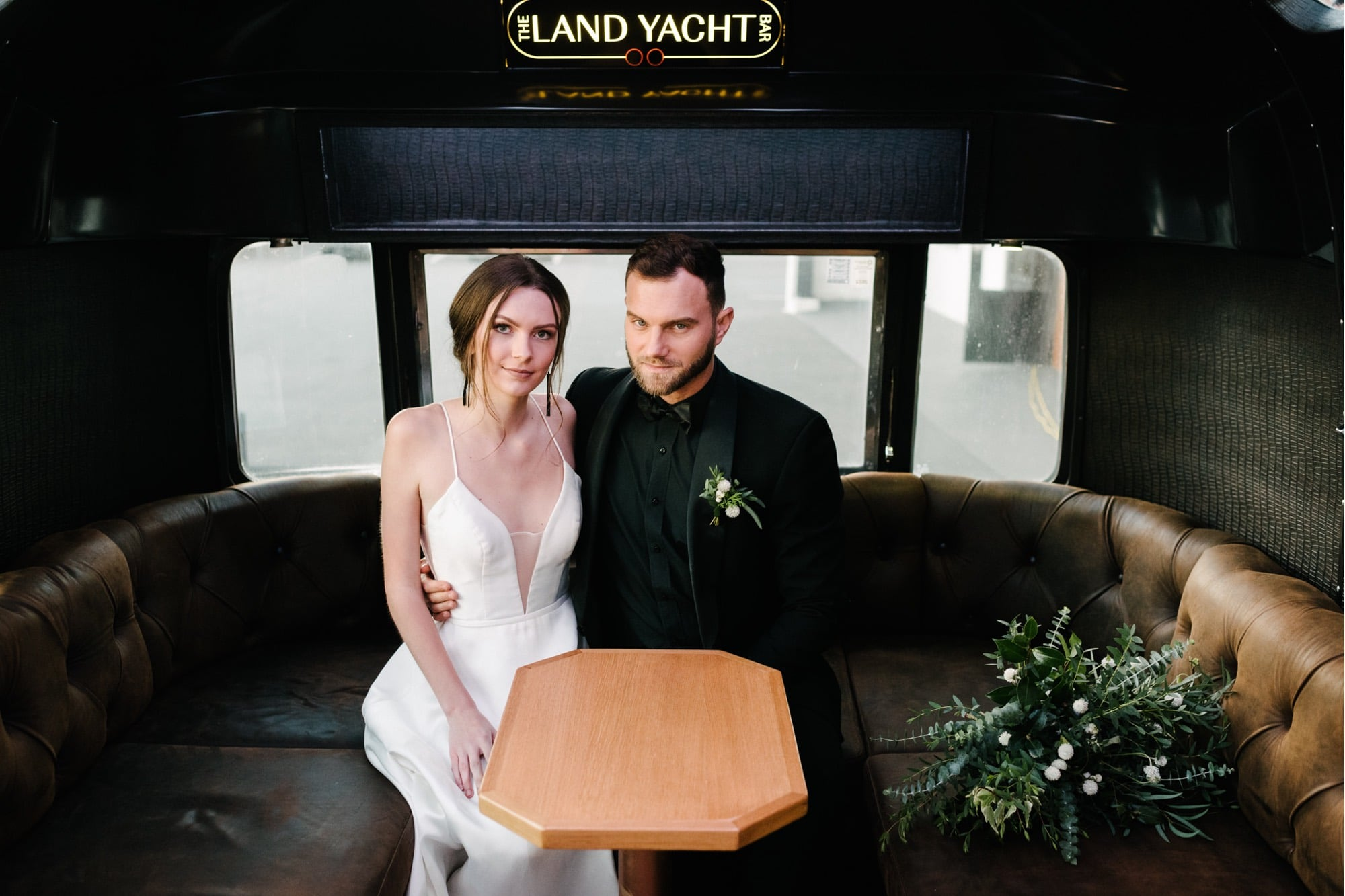Bride and groom inside The Land Yacht Bar