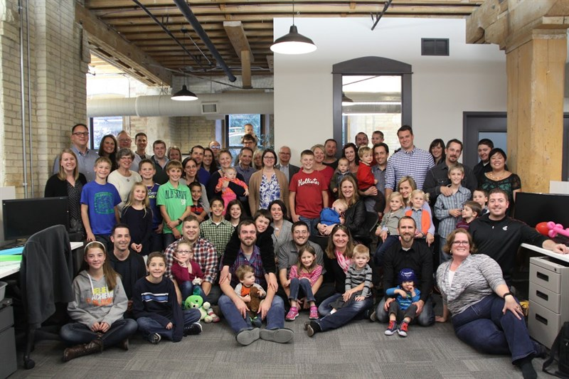C2 Team members bring family members to new office space for open house