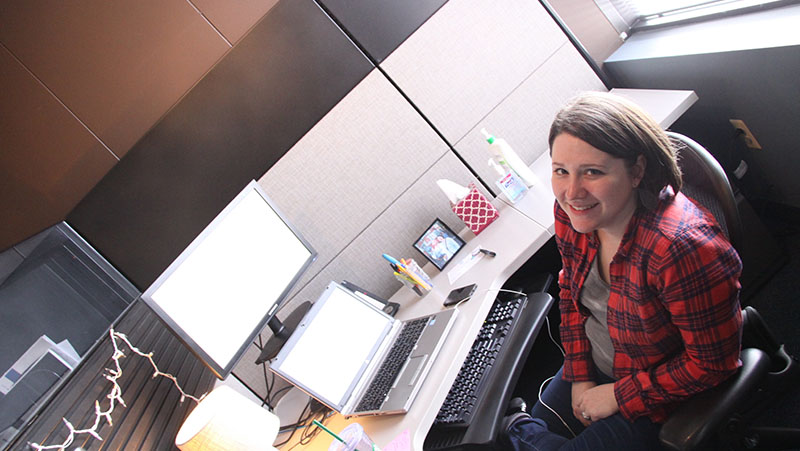 C2's Front-End Developer, Genevieve Nelson at her desk