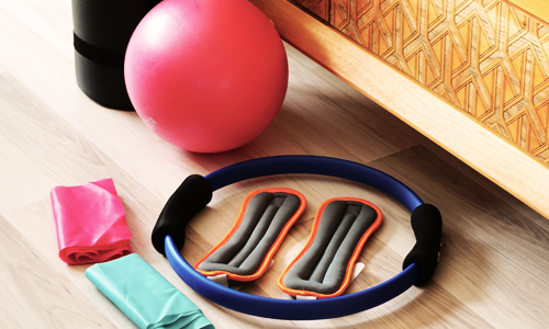 Organize your home gym equipment to make workouts easier to repeat
