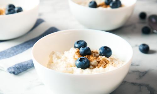 Three bowls of porridge to illustrate James Clear's Goldilocks Rule for establishing realistic fitness goals