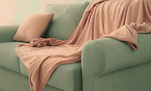 A green couch to sit on when motivation to exercise falls flat