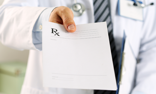 A doctor handing over a prescription note like a personal trainer prescribes an individualized fitness plan