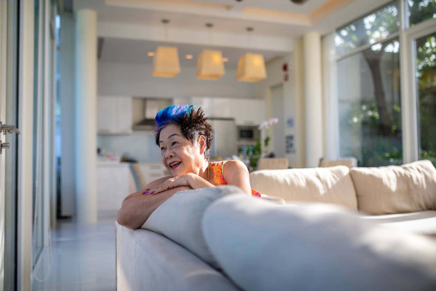 Blue haired woman sitting on couch