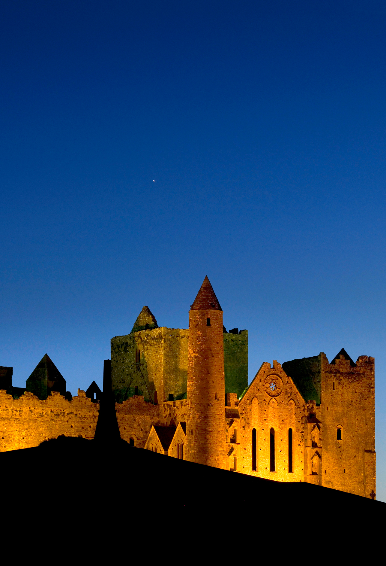 The Rock of Cashel at dusk illuminated by flood lights