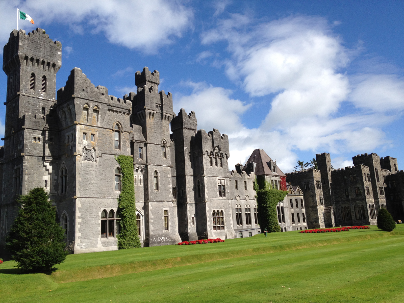 Ashford Castle on a gorgeous sunny day - a much loved featured on our Irish Castles and Classics Essential Ireland Tour
