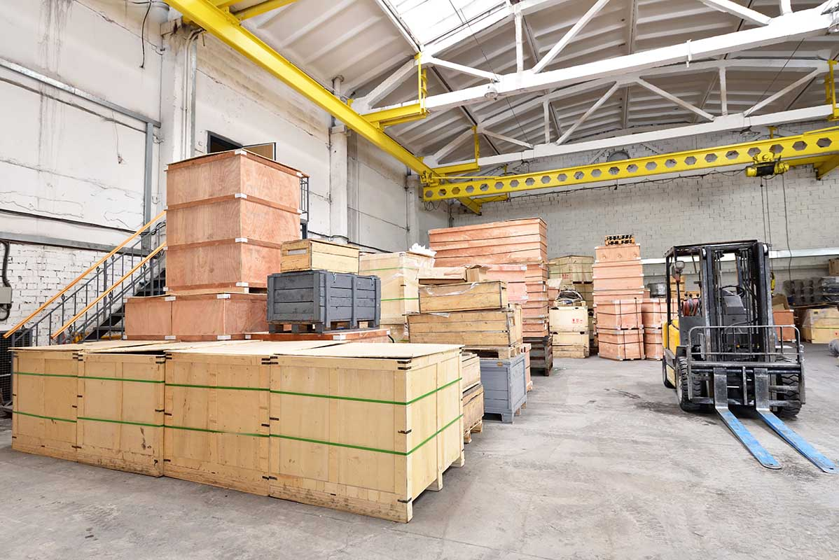 Timber crates stored in warehouse