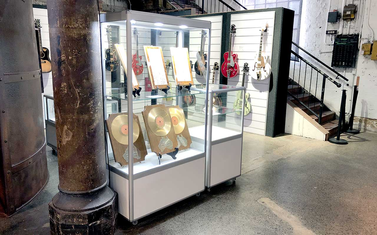 Display cabinet containing music memorabilia